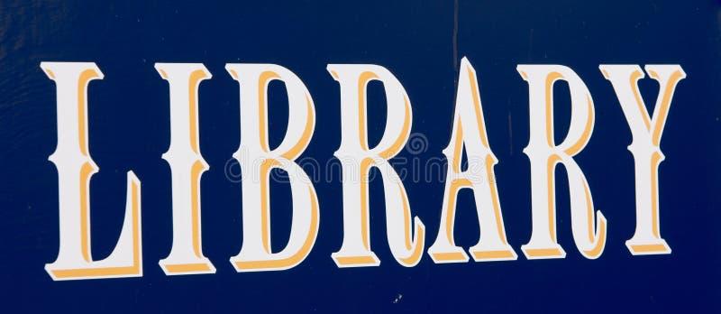 Blauw bibliotheekteken stock afbeeldingen
