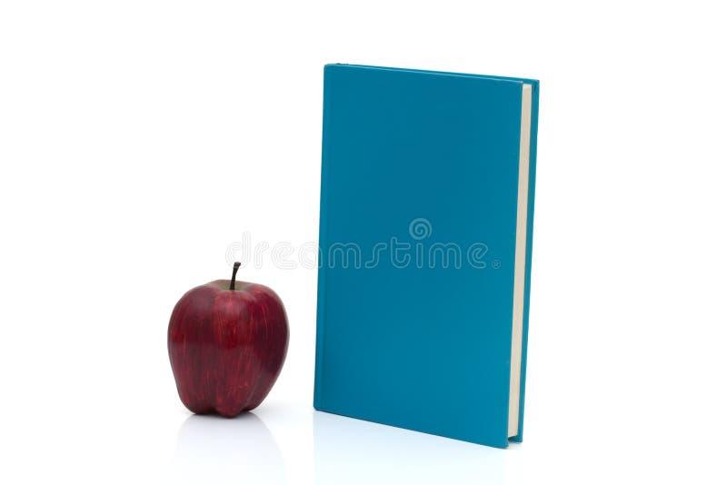 Blauw Boek met een appel royalty-vrije stock afbeeldingen
