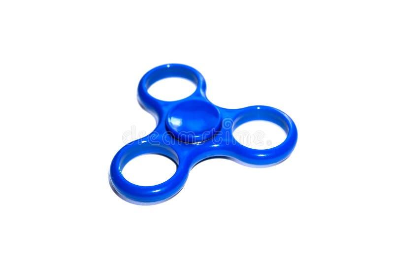 Blauw die van de de spanningsbezorgdheid van de vingerspinner de hulpstuk speelgoed op witte achtergrond wordt geïsoleerd royalty-vrije stock foto's