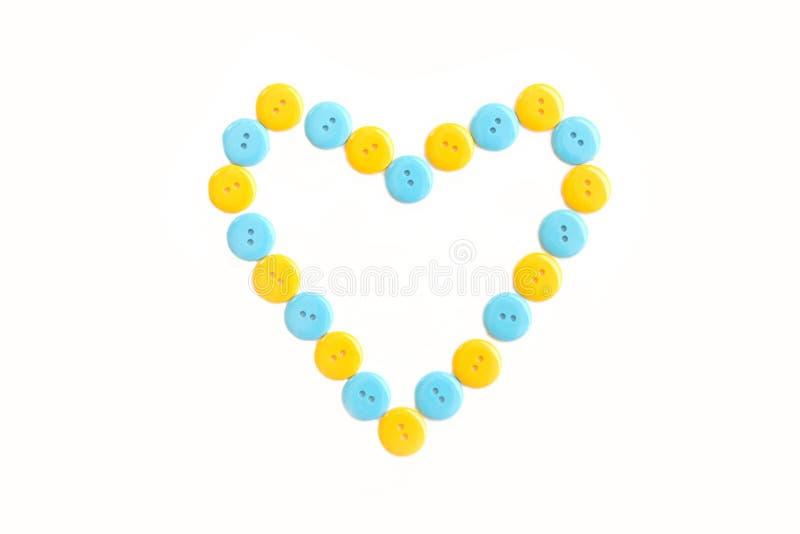 Blauw en geel hart van plastiek clasper royalty-vrije stock fotografie