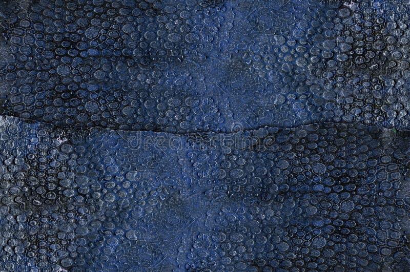 Blauw en goud in reliëf gemaakte pleisterachtergrond royalty-vrije illustratie