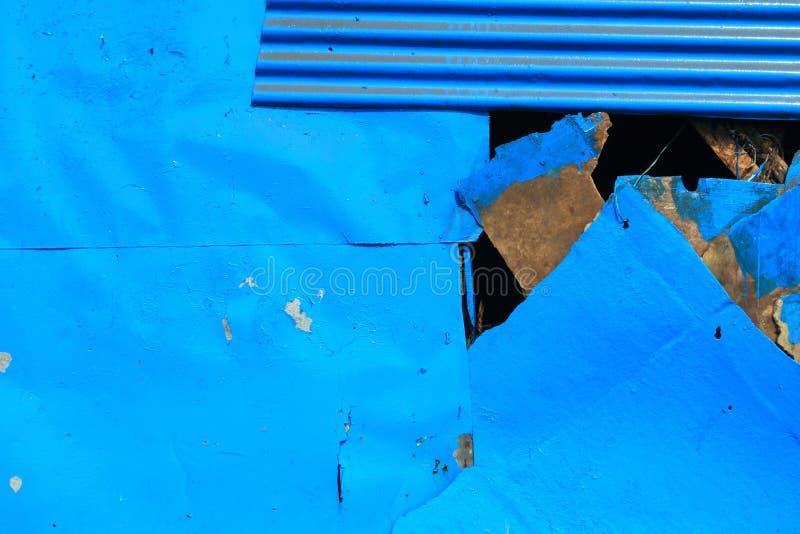 Blauw geschilderd metaal stock fotografie