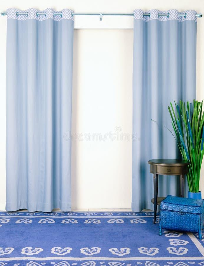 Blauw gordijn stock fotografie