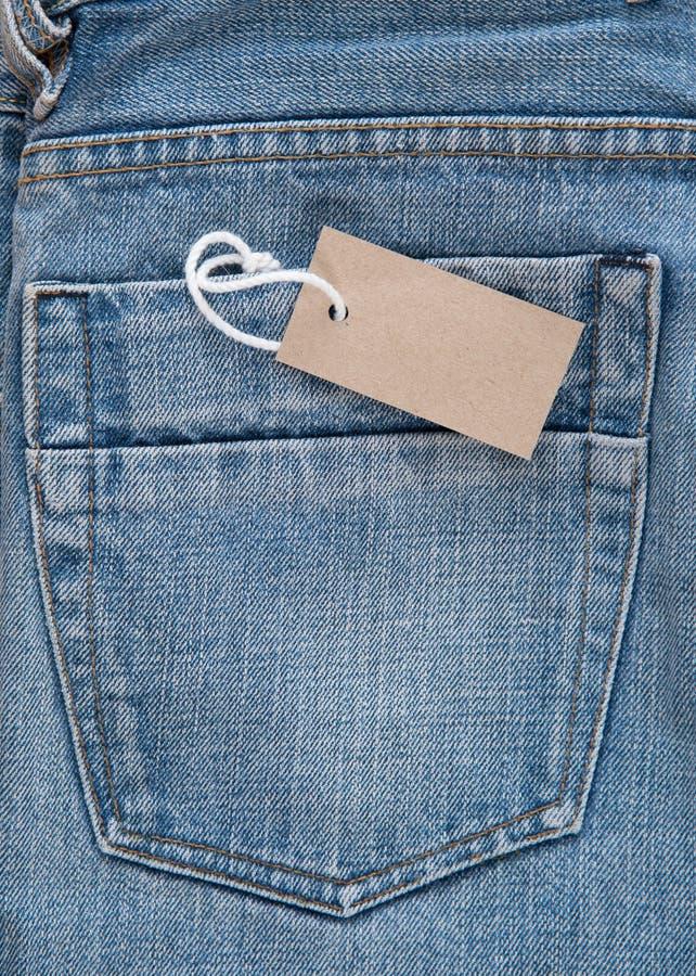 Blauw Jean met prijskaartje stock afbeeldingen