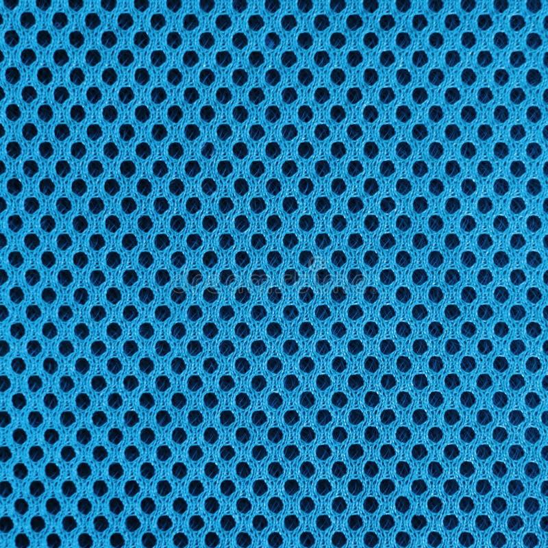 Blauw in te ademen poreus poriferous materiaal voor luchtventilatie met gaten Sportkledings materiële nylon textuur vierkant royalty-vrije stock foto