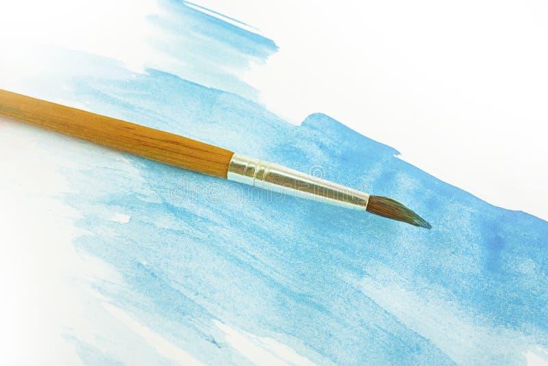 Blauw waterverf en penseel stock fotografie