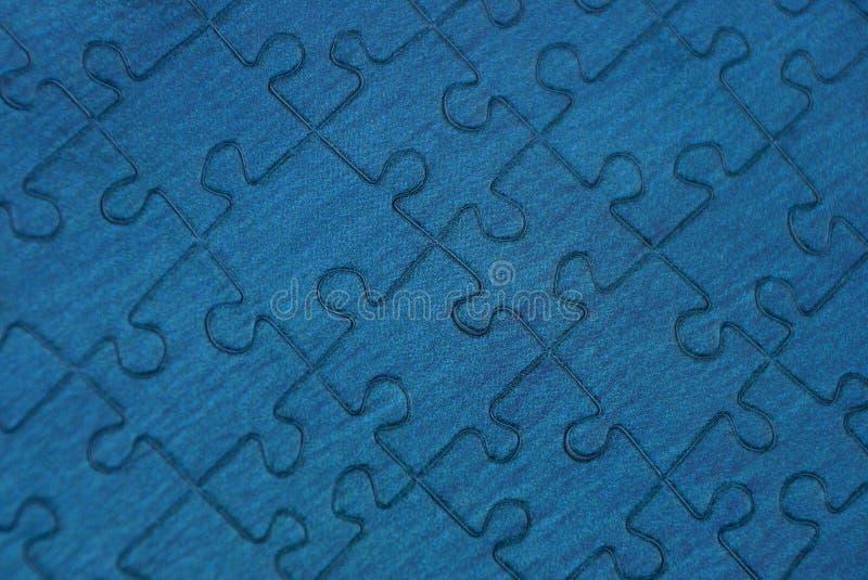 Blauwe achtergrond van een stuk van document raadsel royalty-vrije stock foto's