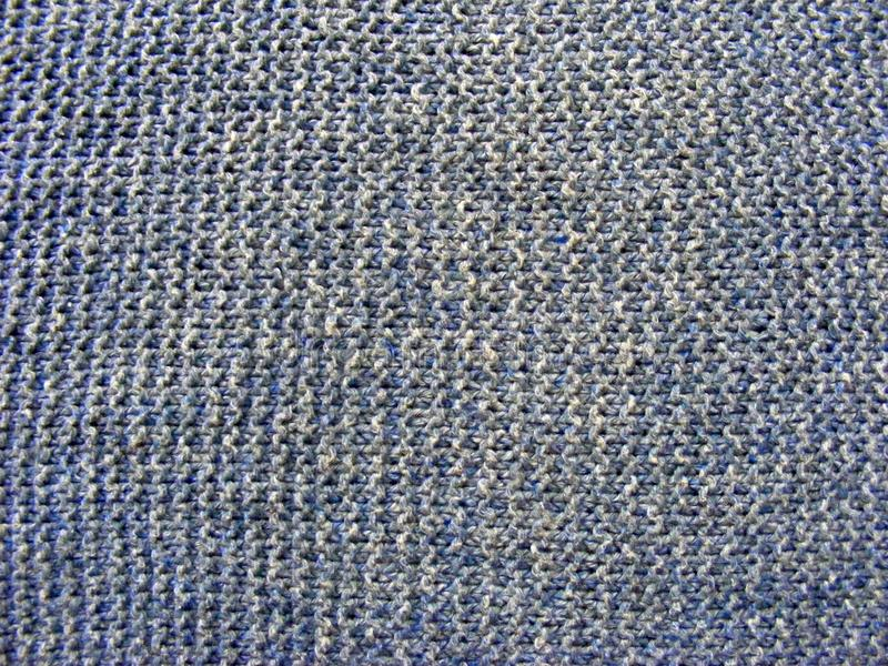 Blauwe bleke wollen gebreide stoffentextuur stock afbeelding