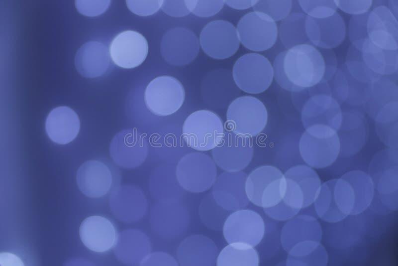 Blauwe bokehsamenvatting als achtergrond stock foto