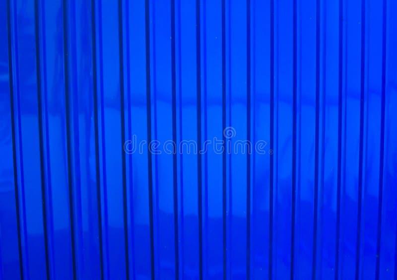 Blauwe die zinkachtergrond in een muur wordt gemaakt stock fotografie