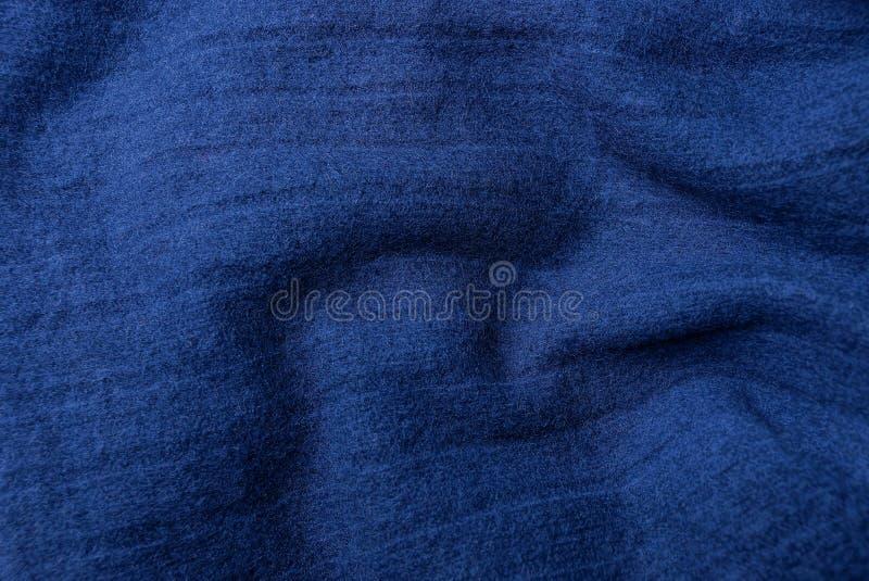 Blauwe donkere stoffentextuur van wollen doek van kleren royalty-vrije stock afbeelding