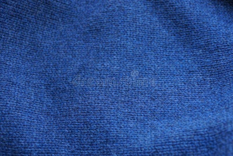 Blauwe donkere textuur van muntachtige wollen klerenstof stock afbeeldingen