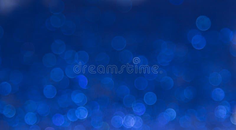 Blauwe elegante abstracte bokehachtergrond royalty-vrije stock foto's