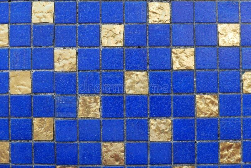 Blauwe en gouden ceramische muur en vloertegel abstracte achtergrond royalty-vrije stock afbeelding