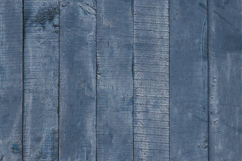 Blauwe en grijze houten lijst dichte omhooggaand De houten raad schilderde in grijs blauw De uitstekende achtergrond van de houtt royalty-vrije stock fotografie