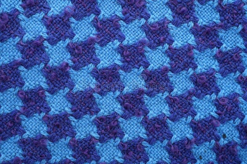 Blauwe en purpere de stoffentextuur van de woltweed stock afbeelding