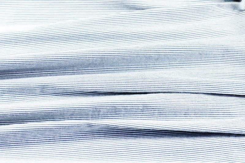 Blauwe en witte stof met strepen stock afbeelding