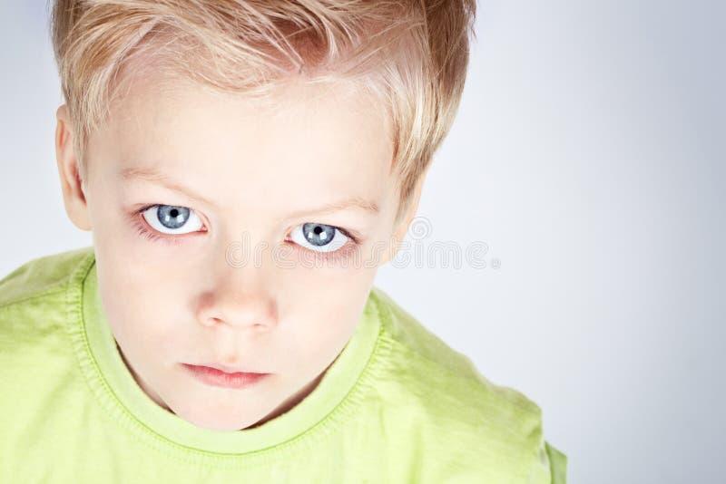 Blauwe eyed jongen stock afbeeldingen