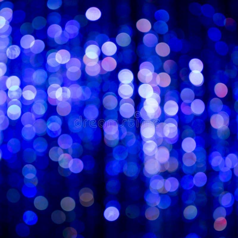 Blauwe Feestelijke Kerstmis elegante abstracte achtergrond met bokeh royalty-vrije stock afbeeldingen