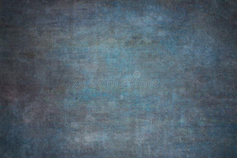 Blauwe geschilderde canvas of mousselinestudioachtergrond stock afbeeldingen