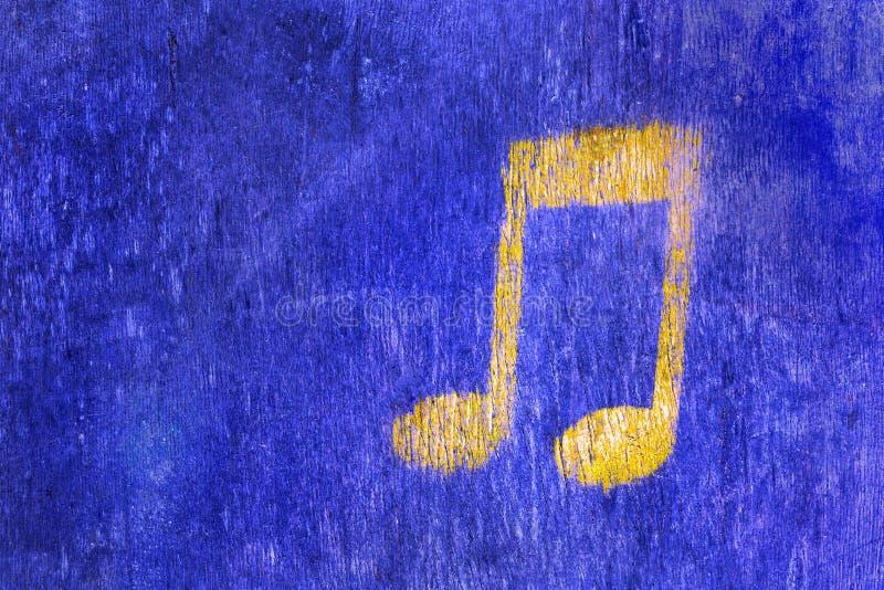 Blauwe houten textuurachtergrond met een muzikaal teken royalty-vrije stock afbeelding