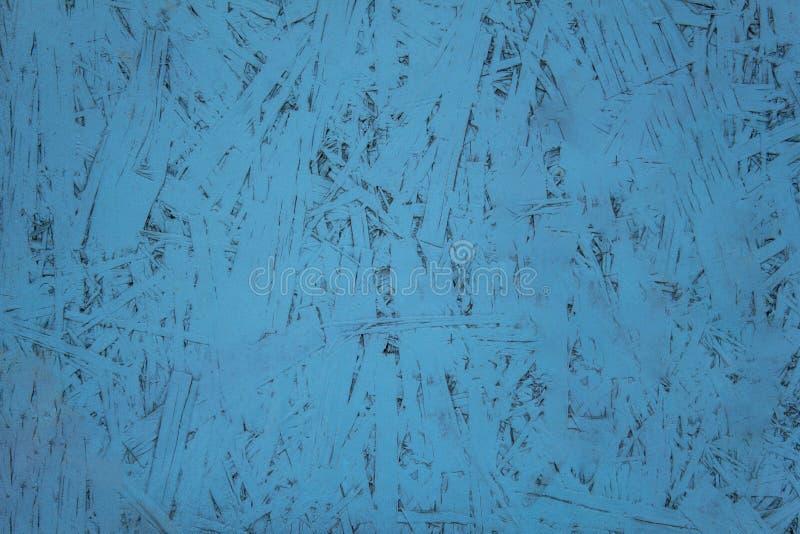 Blauwe houtvezelplaatclose-up Ruwe Oppervlaktetextuur stock afbeeldingen