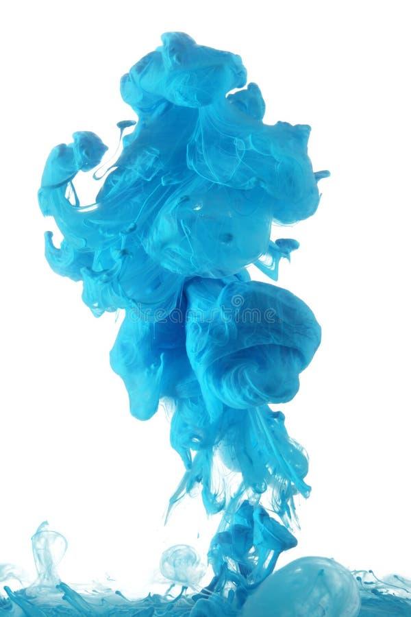Blauwe inkt in water stock foto