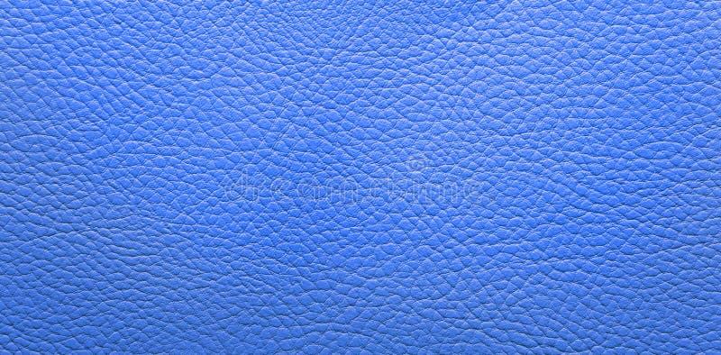 Blauwe leerachtergrond stock foto's