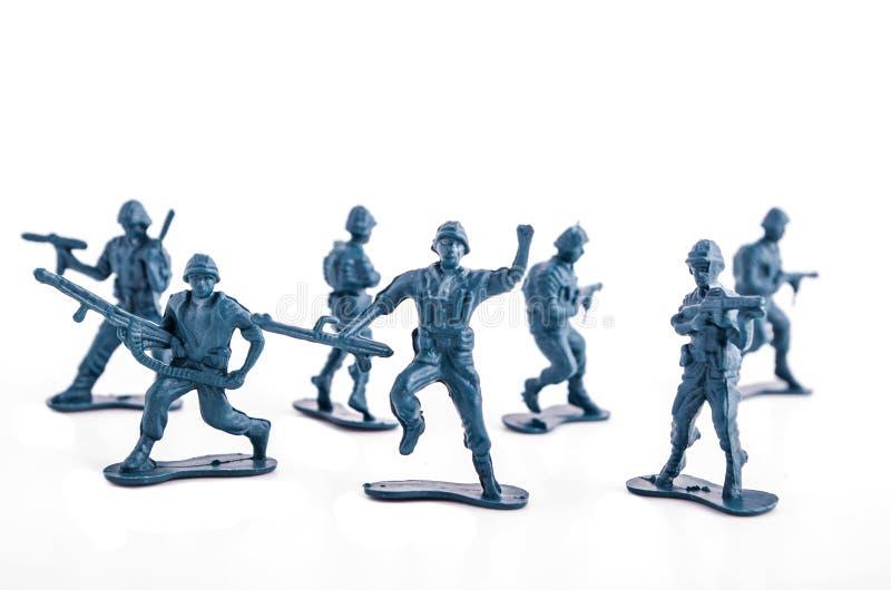 Blauwe legerstuk speelgoed militairen stock foto's