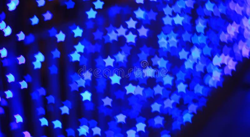 Blauwe lichte bokehachtergrond van de stervorm royalty-vrije stock afbeelding