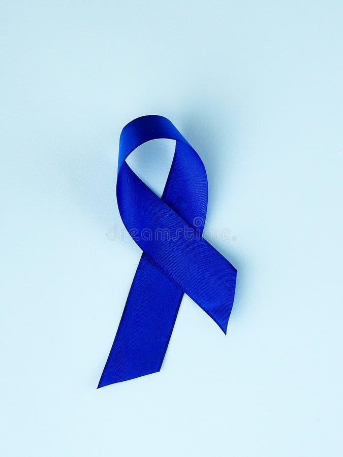 Blauwe lintvoorlichting Dubbelpuntkanker, Colorectal Kanker, de voorlichting van het Kindmisbruik, de dag van de werelddiabetes royalty-vrije stock foto's