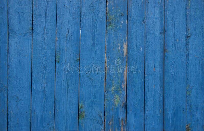 Blauwe omheining van houten planken royalty-vrije stock foto