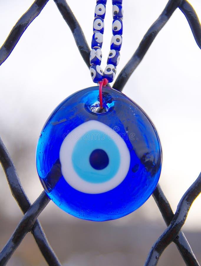 Blauwe oogamulet stock afbeelding