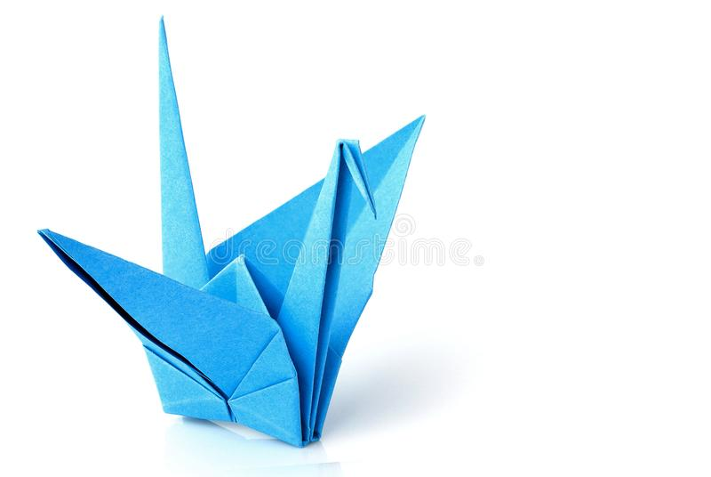 Blauwe origamikraan; vogel geïsoleerde close-up stock foto's