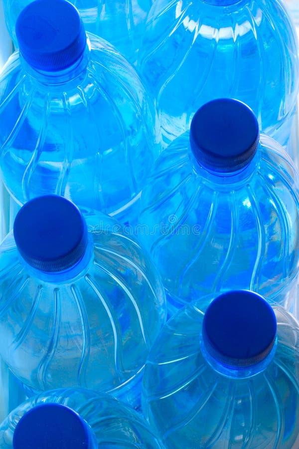 Blauwe plastic flessen royalty-vrije stock foto's