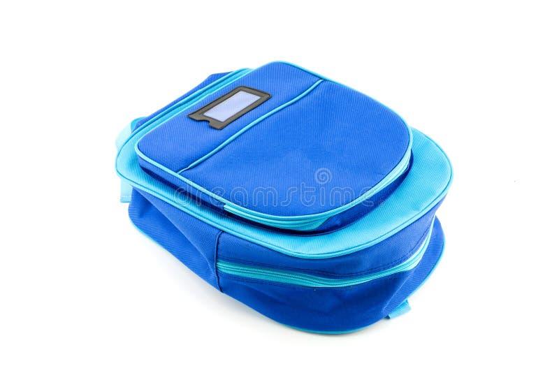 Blauwe rugzak met geïsoleerde schoollevering royalty-vrije stock afbeelding