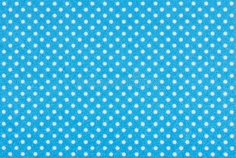 Blauwe stof met witte stippen stock foto