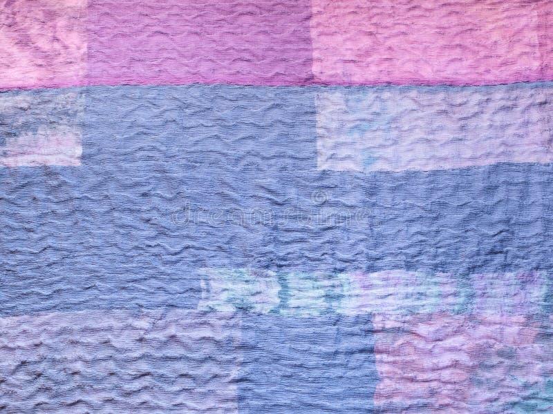 Blauwe stof op lapwerkdoek stock afbeeldingen