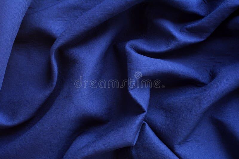 Blauwe stoffenachtergrond royalty-vrije stock foto's
