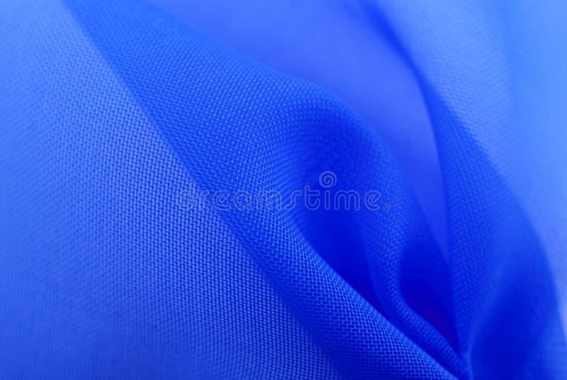 Blauwe stoffentextuur stock foto