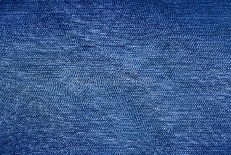 Blauwe stoffentextuur van fijngestampt en sjofel denim royalty-vrije stock fotografie