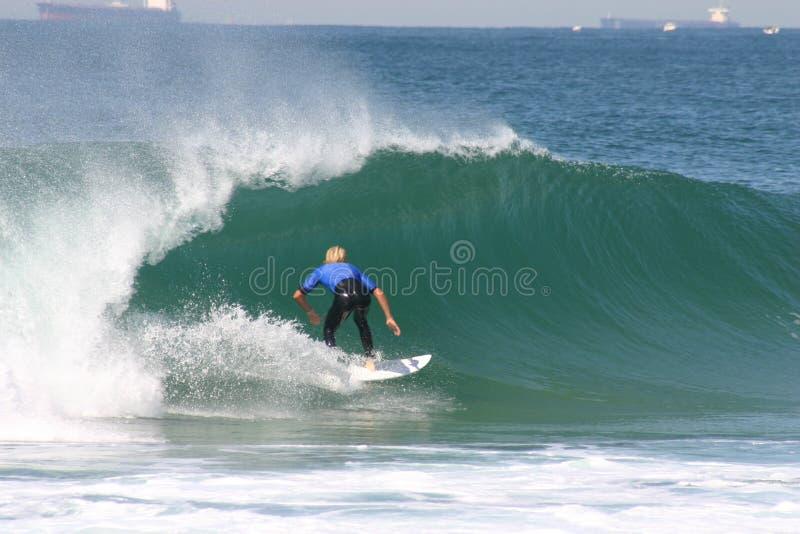 Blauwe surfer royalty-vrije stock afbeeldingen