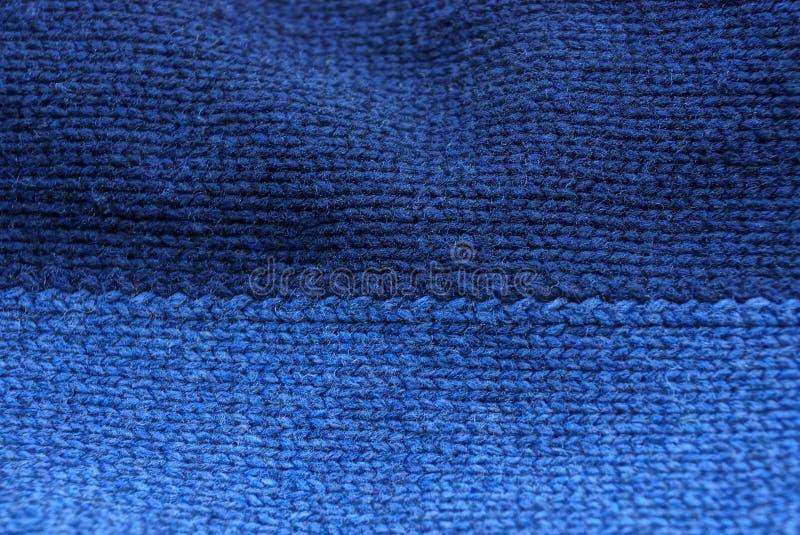 Blauwe textuur van een stuk van donkere wollen doek stock afbeeldingen