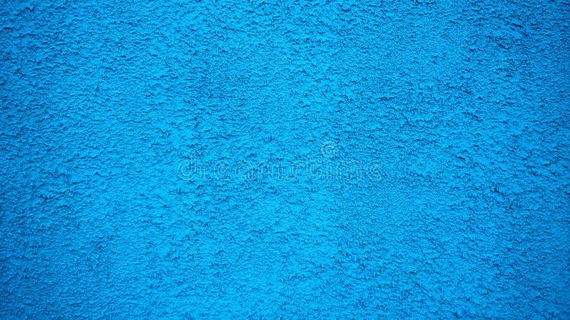 Blauwe uitstekende de stijlachtergrond van de muurgipspleister Geschilderde oppervlakte, een oud concreet gebouw in stad stock afbeelding