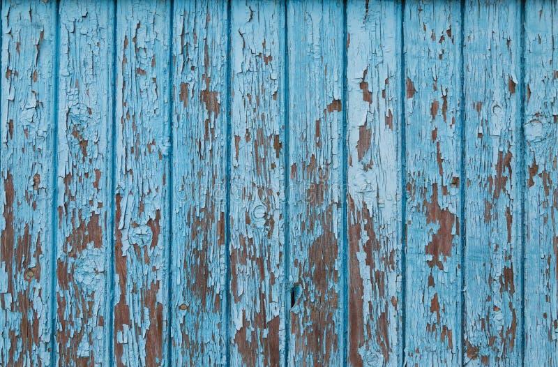 Blauwe uitstekende houten achtergrond met schilverf stock afbeelding