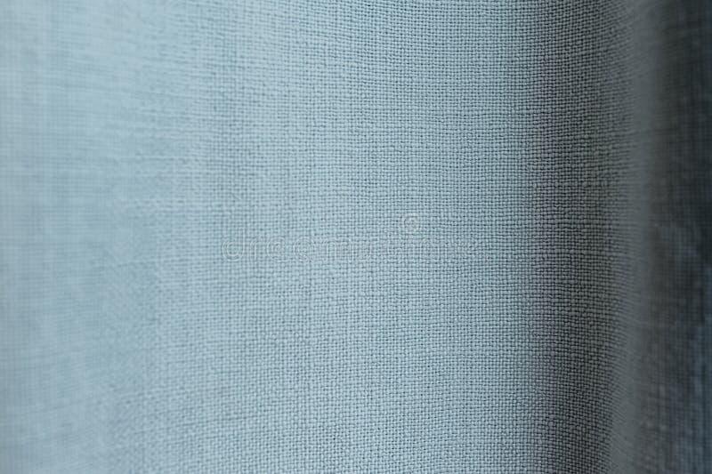 Blauwe uniforme textuur van katoenstof met grote draden en knopen royalty-vrije stock foto's