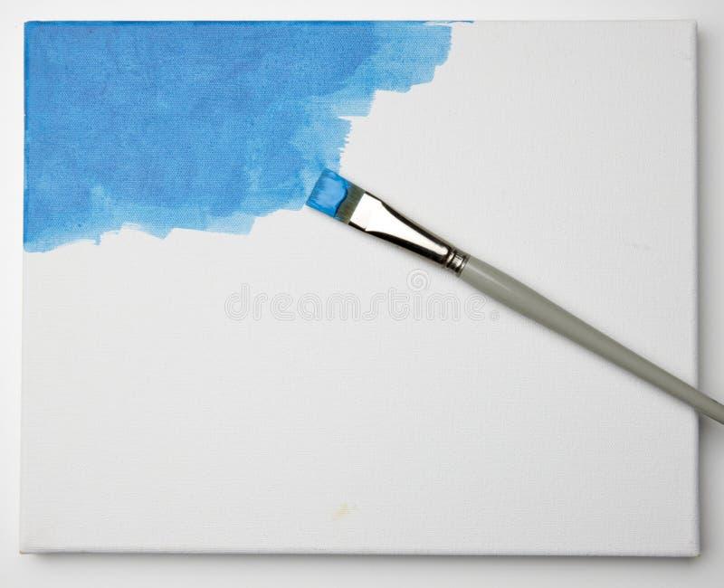 Blauwe verf op canvas stock foto
