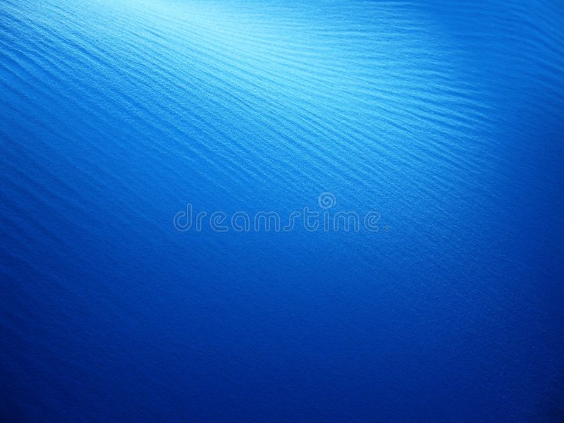 Blauwe zandachtergrond stock foto
