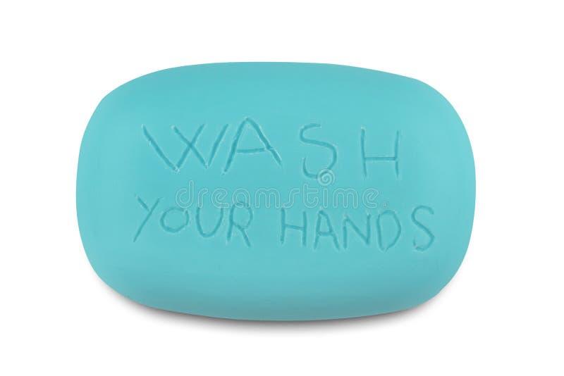 Blauwe zeepbar met was uw geschreven handen stock afbeelding