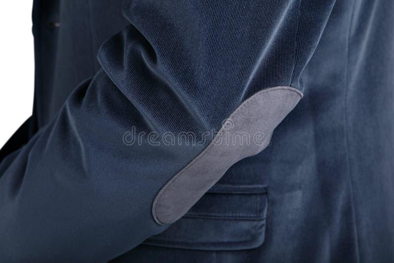 Blazer dos homens dos azuis marinhos de veludo do close-up, isolado sobre o branco fotos de stock royalty free